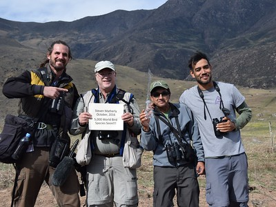 The sign says it all...it was a big milestone day for participant Steve Matherly! Guides Jesse Fagan and Willy Perez, either side of Steve, and local guide Emiliano pause for a celebratory pic.