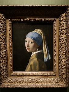 "Vermeer's ""Girl with Pearl Earring"" is a fine way to brighten an afternoon! Godfried and Jay contend that the luminosity of the paintings of Rembrandt and Vermeer only comes through when one is face to face with the paintings themselves. (Photo by guide Godfried Schreur.)"