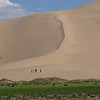 People are truly tiny in the immense landscape of the Khongor dunes. Photo by guide Phil Gregory.