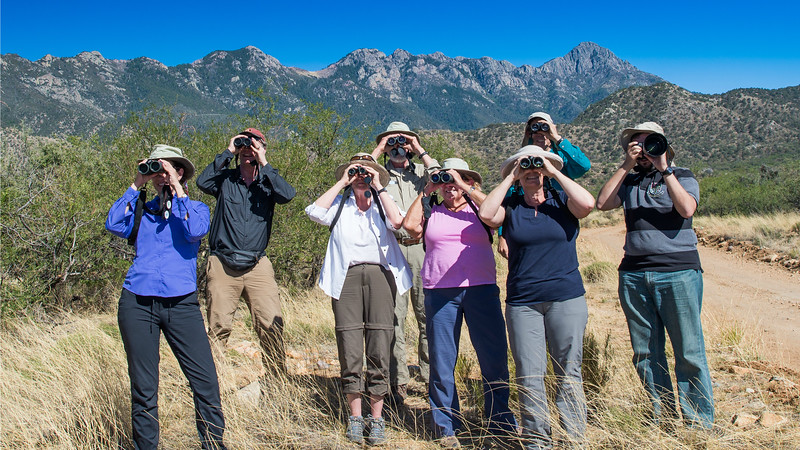 Birding in AZ has a lot of nice backdrops! Participant Herb Fechter shared this photo of guide Dave Stejskal (2nd from l.) and group.