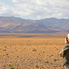 """Part of Morocco features dramatic desert scenery.  Here's Kurt birding the Tagdilt Track. <div id=""""caption_tourlink"""" align=""""right""""> [Photo © George Armistead]</div>"""