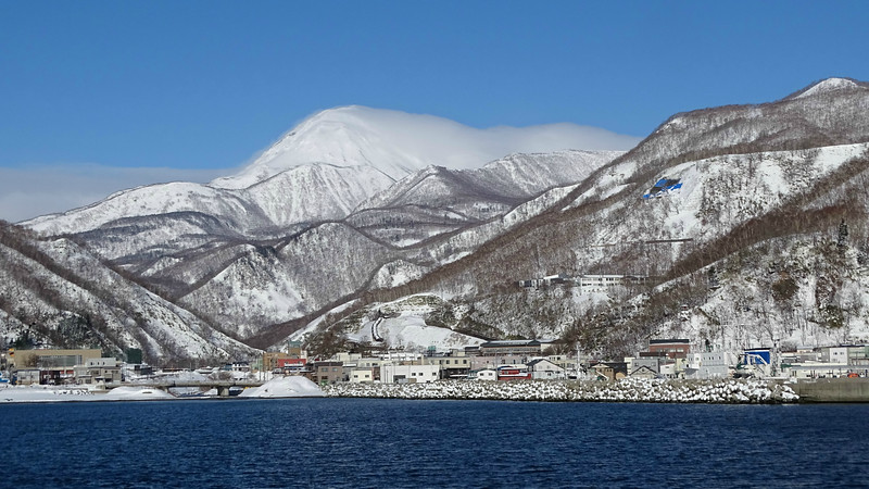 Those are the Rausu Mountains beyond this port community on the Shiretoko Peninsula. Photo by guide Phil Gregory.