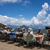 Sun protection at a field lunch is in order at 2800m elevation high up in the Andes, from hats with flaps, to an umbrella, to dark glasses. (Photo by guide Richard Webster)