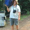 """Guide Jay VanderGaast is willing to do it all to make sure you are comfortable and having a good time. Our """"Vanga"""" is helping with the luggage on our New Guinea & Australia tour highlighted in this penultimate set of images. Photo by participant Eve Wee."""