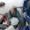 Yep, there's cocktail hour on the ship. Returning from a shore outing, guide John Coons delivers some fresh ice for the occasion! (Photo by participant Jan Shaw)