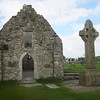 One of the three High Crosses of Clonmacnoise (ancient center of Irish scholarship, literature, and art).  High cross carvings tell stories.  The circle on the cross represents the sun, since these ancient peoples were sun worshipers influenced by Christianity. (Photo by guide Terry McEneaney)
