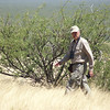 Part man, part desert, guide John Coons glides purposefully in pursuit of those specialties...