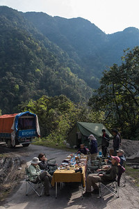 """Only in Bhutan can we take over one of two lanes of the road for a breakfast picnic, and everyone is """"cool"""" with it! (And everyone is not many--there's very little traffic in this remote national park). (Photo by guide Richard Webster)"""