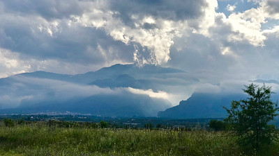 Dramatic lighting seems appropriate for this distant view of Mount Olympus. Photo by participant Rick Woodruff.