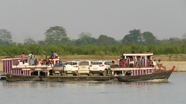 Space is at a premium on the ferry across the Brahmaputra River. Photo by guide Phil Gregory.