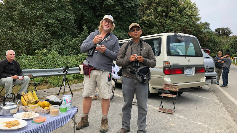 Guide Jay VanderGaast (l.) and co-leader Uthai Treesucon enjoying a field meal, while perhaps planning their next move.  Photo by participant Greg Vassilopoulos.