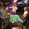 """Some of our group headed to a local bar after hours one evening for a little """"team-building"""" around the foosball table. Tom Johnson referees (seriously!) with, from left, players Jesse Fagan, Sharon Mackie, Mandy Mantzel, and Doug Gochfeld."""