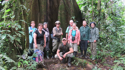 The birding was so good...of course we were all smiles, with guide Mitch Lysinger crouching in front. Photo by participant Bruce Cressman.