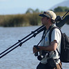 Co-leader Ricardo Matus in full birding gear -- and note the no-hands scope-shouldering technique! (Photo by guide Peter Burke)