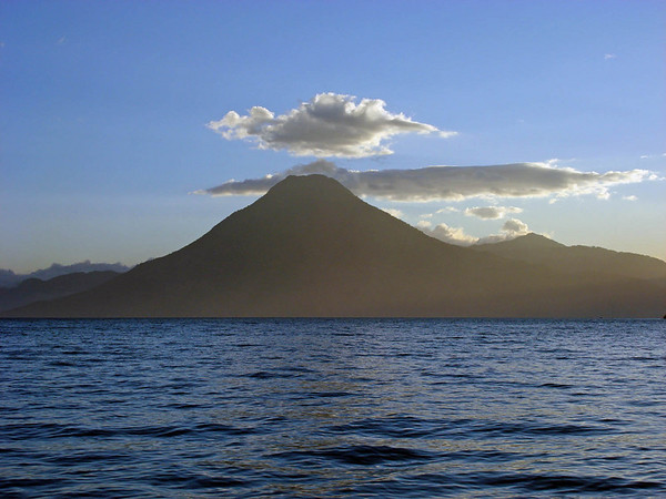 "Back down to Earth and back on the continental mainland, the classic cone of Volcan San Pedro looms across Lake Atitlan in this photo from one of our 2008 <i>Guatemala: Shade-grown birding & Horned Guan Hike</i> tour in this image by guide Alvaro Jaramillo.<div id=""caption_tourlink"" align=""right"">Link to: <a id=""caption_tourlink"" href=""http://www.fieldguides.com/guatemala.htm"" target=""_blank"">GUATEMALA: SHADE-GROWN BIRDING & HORNED GUAN HIKE</a><br>[photo © Alvaro Jaramillo]</div>"