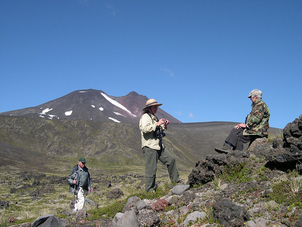 """Participants Dick Spight, Barbara Williams, Judith Fortney exploring and enjoying the terrain in the crater of Antillanca volcano on our inaugural <i>The Heart & Sole of Chile</i> tour in this photo from participant Joy Wallis.<div id=""""caption_tourlink"""" align=""""right"""">Link to: <a id=""""caption_tourlink"""" href=""""http://www.fieldguides.com/chileheartsole.htm"""" target=""""_blank"""">THE HEART & SOLE OF CHILE</a><br>[photo © Joy Wallis]</div>"""