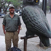 "George, whose nickname is ""the owl,"" discovers a statue all his own along our route in Bolivia. (Photo by guide Dan Lane)"