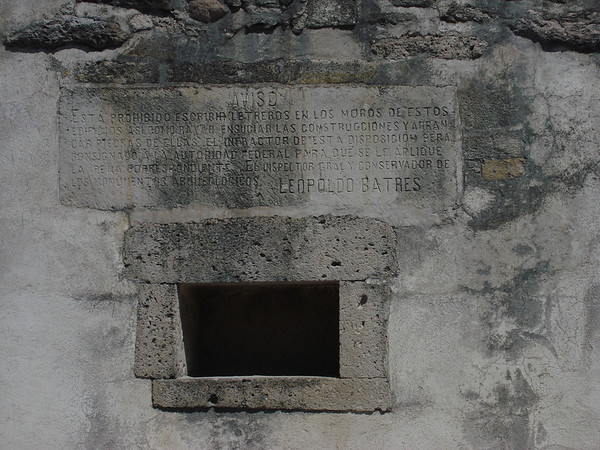 "The inscription says ""It is prohibited to write signs on the walls of this ruin..."" As Dan noted: ""Hmmm...odd way to try to convey that message."" Indeed!<div id=""caption_tourlink"" align=""right"">[photo © guide Dan Lane]</div>"