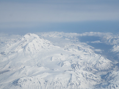 Participant Pat Newman peeked out the plane window en route back from the Pribilofs to spot these mountains west of Cook Inlet near Anchorage...just another day in the sky over Alaska -- wow!Link to: ALASKA[photo © participant Pat Newman]
