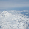 "Participant Pat Newman peeked out the plane window en route back from the Pribilofs to spot these mountains west of Cook Inlet near Anchorage...just another day in the sky over Alaska -- wow!<div id=""caption_tourlink"" align=""right"">Link to: <a id=""caption_tourlink"" href=""http://www.fieldguides.com/alaska.htm"" target=""_blank"">ALASKA</a><br>[photo © participant Pat Newman]</div>"