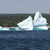 "This iceberg was aground in Witless Bay during our group's visit.  Having traveled south from Greenland in the currents, it was now on its last legs.  The following morning, it had toppled over and was shrinking rapidly.<div id=""caption_tourlink"" align=""right"">Link to: <a id=""caption_tourlink"" href=""http://www.fieldguides.com/novascotia.htm"" target=""_blank"">NEWFOUNDLAND & NOVA SCOTIA</a><br>[photo © Chris Benesh]</div>"