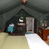 """""""Roughing it"""" in Masai Mara on the Kenya tour — tent camping with a private shower! <div id=""""caption_tourlink"""" align=""""right""""> [Photo © participant Daphne Gemmill]</div>"""