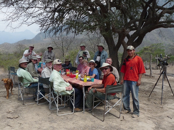 "The ""Grebe"" (aka Rose Ann) also grabbed this photo of our group having a little outdoor sit-down lunch back near camp after a successful outing for White-winged Guans at Quebrada Limon.  That's co-leader Richard Webster seated at far left. <div id=""caption_tourlink"" align=""right""><a id=""caption_tourlink"" href=""http://www.fieldguides.com/tours.html?area=tour&code=npe"" target=""_blank"">More about this tour...</a></div>"