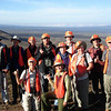 """Palila-search costume time -- aahh, the things we birders have to wear to meet local rules and regs. It must have been OK, though -- folks are making the shaka sign! (Don't you just <i>love</i> guide George Armistead's new look at back center?!?) <div id=""""caption_tourlink"""" align=""""right""""> [Photo © guide Rose Ann Rowlett]</div>"""