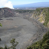 """The islands, formed entirely by the activity of a geologic """"hotspot"""" in the middle of the Pacific Ocean, show a great variety of volcanic features. Here we see the Kilauea Caldera, with Halema'uma'u Crater in the distance.<div id=""""caption_tourlink"""" align=""""right""""> [Photo © guide Rose Ann Rowlett]</div>"""