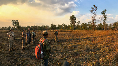 Our Cambodia group birding the dry dipterocarp forest at Tmatboey, home to a unique mix of birds. Photo by guide Doug Gochfeld.