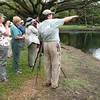 "Guide Dan Lane points out something of interest at Wailoa River State Park.<div id=""caption_tourlink"" align=""right"">Link to: <a id=""caption_tourlink"" href=""http://www.fieldguides.com/hawaii.htm"" target=""_blank"">HAWAII</a><br>[photo © Linda J. Nuttall]</div>"