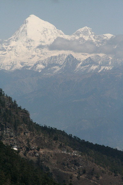"One of the features of mountainous Bhutan is, of course, the backdrop of the Himalayas.  Here's Jholmahari Peak, one of Bhutan's highest mountains, in an image from guide Richard Webster.<div id=""caption_tourlink"" align=""right"">Link to: <a id=""caption_tourlink"" href=""http://www.fieldguides.com/bhutan.htm"" target=""_blank"">BHUTAN</a><br>[photo © Richard Webster]</div>"
