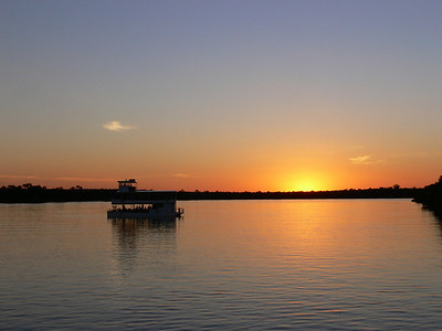Sunset at the tail end of a sundowner cruise on the famous Zambezi River, along which lie famous Victoria Falls.Link to: ZAMBIA & MALAWI[photo © Marge Barrett]