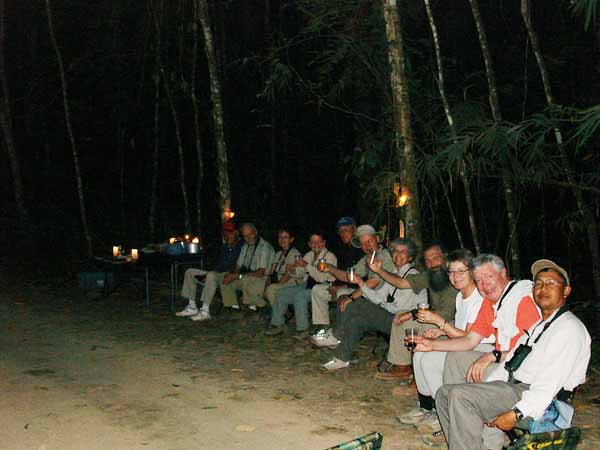 """Our 2008 Thailand group celebrating a fabulous day of birding in Kaeng Krachan NP with a candlelight dinner.<div id=""""caption_tourlink"""" align=""""right"""">Link to: <a id=""""caption_tourlink"""" href=""""http://www.fieldguides.com/thailand.htm"""" target=""""_blank"""">THAILAND</a><br>[photo © Rose Ann Rowlett]</div>"""