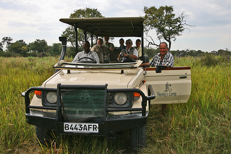 "And finally, Terry Stevenson and group in the safari vehicle from Stanley's Camp in the Okavango Delta<div id=""caption_tourlink"" align=""right"">Link to: <a id=""caption_tourlink"" href=""http://www.fieldguides.com/namibia.htm"" target=""_blank"">NAMIBIA & BOTSWANA</a><br>[photo © participant Paul Thomas]</div>"
