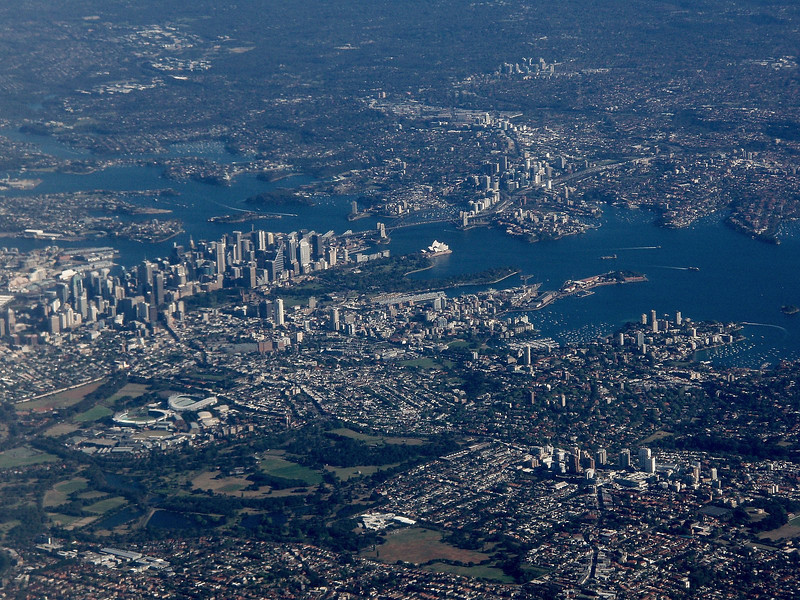 """We begin this month's batch of photos from some recent tours with a great aerial view of Sydney, <b>Australia</b>, photographed by participant Marshall Dahl from his arriving flight. That gleaming white spot in the center? The famous Sydney Opera House, with the Harbour Bridge right above it.  <br><em>(Web page links are in blue above if you'd like more details on any of this month's gallery tours.)</em> <div id=""""caption_tourlink"""" align=""""right""""> [Photo © participant Marshall Dahl]</div>"""