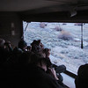 """In the blue pre-dawn light, one of our groups looks out from a blind to see 17 Gunnison Sage-Grouse on their lek. <div id=""""caption_tourlink"""" align=""""right""""> [Photo © guide Dan Lane]</div>"""