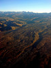 """No slouch in the scenery department, Bolivia can hold its own. Here, a view from the plane headed into La Paz: the Cordillera Real over the altiplano.  <div id=""""caption_tourlink"""" align=""""right""""> [Photo © Dan Lane]</div>"""