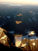 """Another view from the plane: The Cordillera Real in the foreground, with Lake Titicaca in the back. <div id=""""caption_tourlink"""" align=""""right""""> [Photo © Dan Lane]</div>"""
