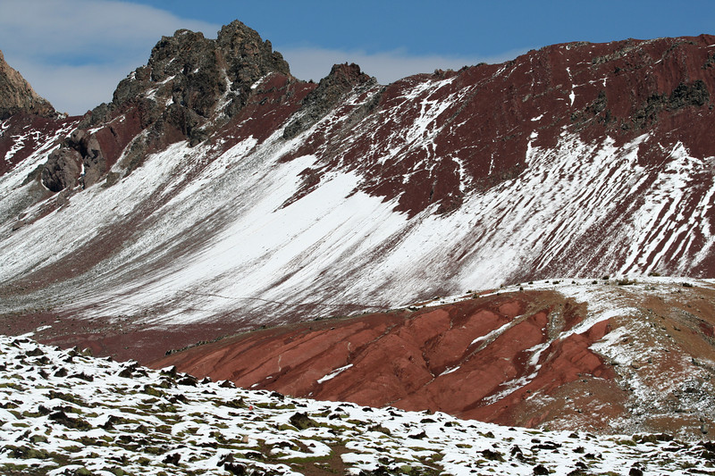 "Fresh snow on the mineral-rich slopes near Ticlio Pass, 15,700 feet. <div id=""caption_tourlink"" align=""right"">[photo © guide Richard Webster]</div>"