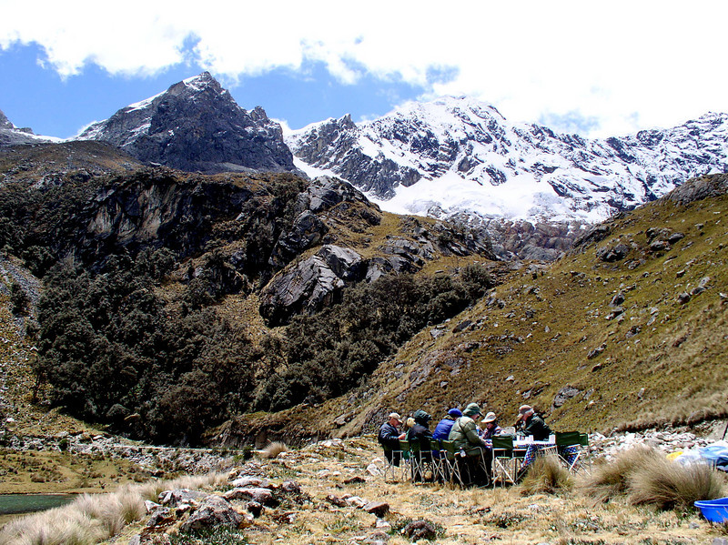 """One of many high-elevation """"picnics with a view"""" on this tour, this one on the upper east slope of Huascaran, overlooking a grove of Polylepis where Ash-breasted Tit-Tyrant can sometimes be found.  <div id=""""caption_tourlink"""" align=""""right"""">[photo © guide Rose Ann Rowlett]</div>"""
