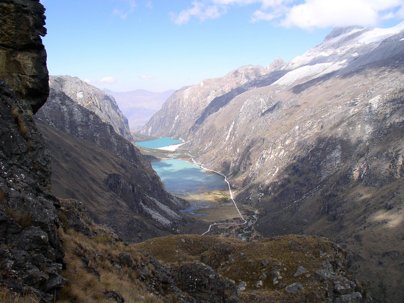"Having climbed slowly up the road below, all the way to the pass, at 14,800 feet, we look back down on puna lakes in the glacier-carved Llanganuco valley.  <div id=""caption_tourlink"" align=""right"">[photo © guide Rose Ann Rowlett]</div>"