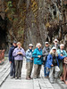 """2008 group at the bridge before the tunnel, at 9200' along the """"Kosnipata Highway"""" through the mountains of Manu (Ron & Nancy, Nancy, Penelope, Rose Ann, Judy & David, Kay)<div id=""""caption_tourlink"""" align=""""right""""><br>[photo © Rose Ann Rowlett]</div>"""