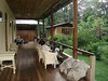 """Relaxing (and watching coquettes) on the veranda at Amazonia Lodge<div id=""""caption_tourlink"""" align=""""right""""><br>[photo © Rose Ann Rowlett]</div>"""