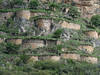 "A telephoto view of the site reveals both circular buildings, typical of Chachapoya structures, and buildings that appear to hug the contours of the slope. It is the latter that gave rise to the name for the site, ""Macro"" meaning ""undulating.""  <div id=""caption_tourlink"" align=""right""><br>[photo © Rose Ann Rowlett]</div>"