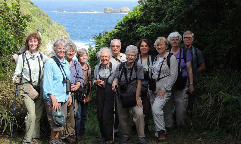 The group poses for the camera at the first overlook on Little Tobago. Surely, there must be a tropicbird behind us somewhere!  (Photo by participant Zolani Frank)