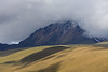 """Extensive grassland surrounds the emergent volcano, the west slopes of which have been losing much of their ice over the last decade. <br><div id=""""caption_tourlink"""" align=""""right""""> [photo © guide Richard Webster]</div>"""