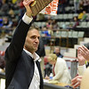 STAN HUDY - SHUDY@DIGITALFIRSTMEDIA.COM<br /> Shenendehowa coach Tony Dzikas holds up the championship plaque as he heads back towards his players at the conclusion of Saturday's Section II Class AA final versus Colonie at the Cool Insuring Arena in Glens Falls. March 3, 2018.