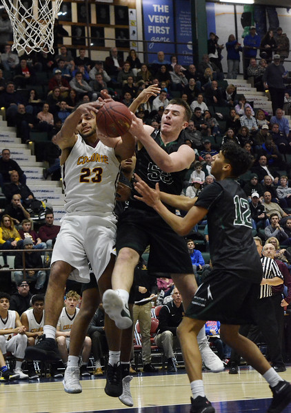 STAN HUDY - SHUDY@DIGITALFIRSTMEDIA.COM<br /> Colonie's Isaiah Moll (23) battles Shenendehowa's James Altenburger under the basket for a loose ball during  Saturday's Section II Class AA final at the Cool Insuring Arena in Glens Falls. March 3, 2018.