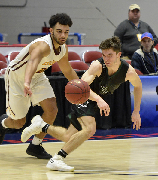 STAN HUDY - SHUDY@DIGITALFIRSTMEDIA.COM<br /> Shenendehowa's Chris Hulbert (right) looks at a ball Colonie's Isaiah Moll (right) knocked away during  Saturday's Section II Class AA final at the Cool Insuring Arena in Glens Falls. March 3, 2018.